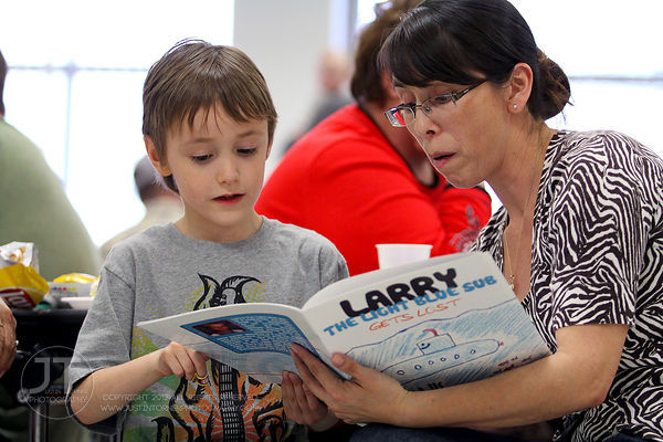 Nick Rotter reads his book, Larry The Light Blue Sub at Mary Welsh Elementary School's Author Night