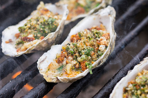 oysters grilling on a backyard barbeque