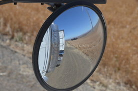 Reflections in truck mirror at harvest