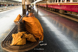 A monk waits for a train at the Bangkok Rail Station in the Pathum Wan District in Thailland. Also known as Hua Lamphong Station.