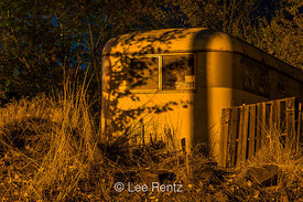 Old Trailer under Sodium-Vapor Lights at Night in Mitchell, Oregon
