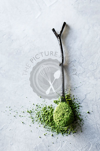 Matcha powder on a wooden twig spoon
