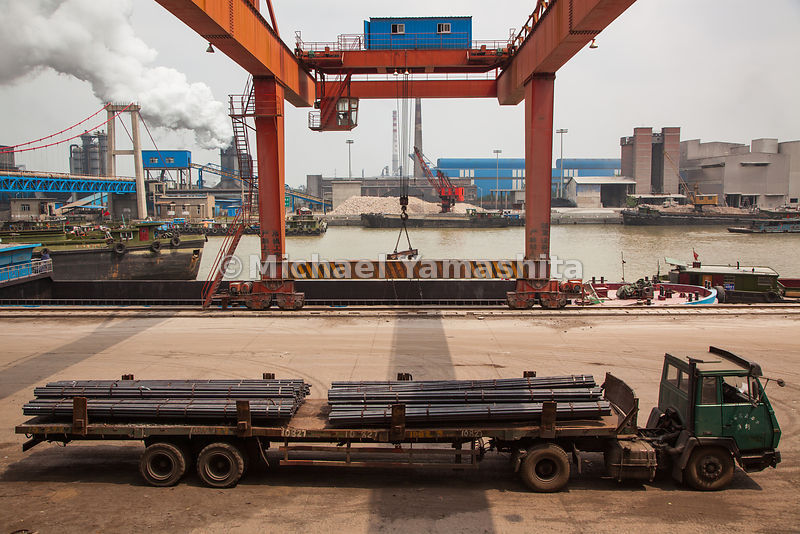 Steel rods on a flatbed at Huaigang Steel in Huaian will be loaded onto barges for shipment on the Grand Canal. The waterway yearly carries some 400 million metric tons of coal, bricks, grain, and other cargo to points between Hangzhou and Jining; north of Jining it has largely dried up.