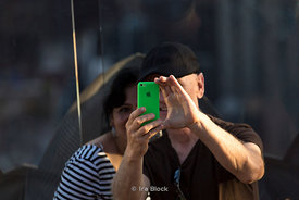 A couple taking a photo with iPhone at Top of The Rock in NY.