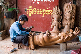 Young man carving a sculpture