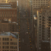 View looking south down State Street with morning traffic and EL trains, Chicago, Illinois, USA
