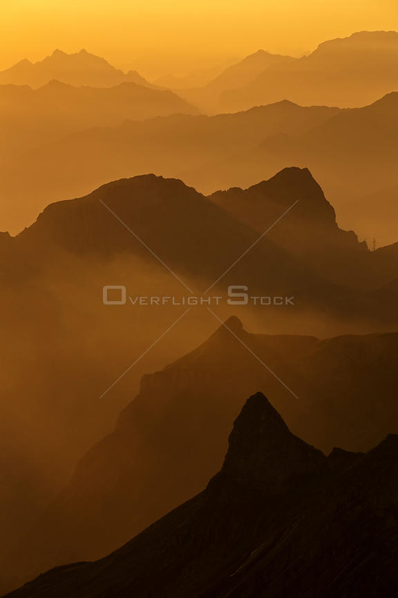 Brienzer Rothorn mountain silhouetted at dawn, Bernese Alps, Switzerland, July 2013.