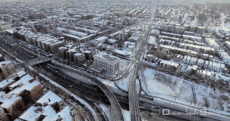 Aerial High Above Snowy Rooftops of Brooklyn Brownstones Bqe Streets Winter NYC