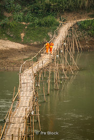 Monks crossing the Nam Khan River near the confluence with the Mekong River in Laos.