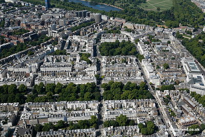 aerial photograph of Belgravia London England UK showing Eaton Square, London SW1W 9AN , St Michael's Church Chester Square, London SW1W 9HH, Eaton Mews , Elizabeth St, SW1W 9PJ , Eaton Pl SW1X 8AL , Eaton Square Gardens and Belgrave Square