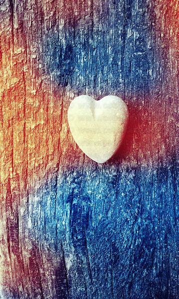 Little heart on old wood with colour light leak effect