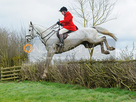 Richard Hunnisett jumping a hedge above Klondike