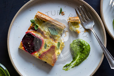 Beetroot ricotta cheese tart with beet greens pesto.