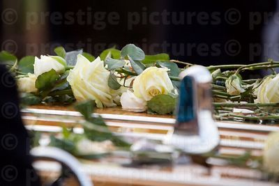 White Roses left behind on the Cortege Carriage