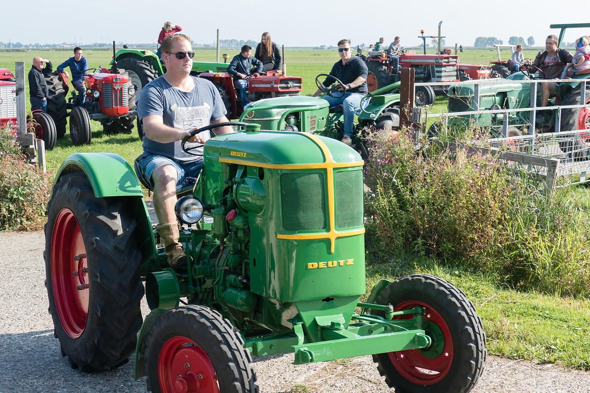 Katwoude, Netherlands - 2018-09-02:  Second Oltimer Tractor Tour, Katwoude - Waterland. Participants of the oldtimer tractor tour on their tractor as they start the tour in Katwoude