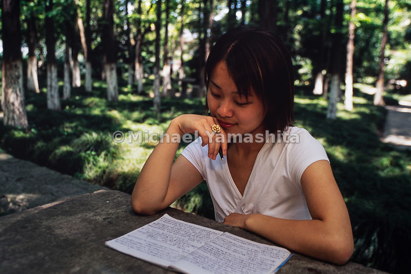 A student from East China Normal University studies in the park in Shanghai, China.