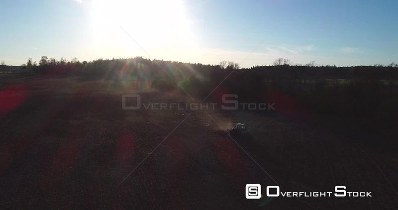 Spring Farming, Aerial View of a Plough Tractor Sowing and Birds Flying Around the Vehicle, Sunny Spring Evening Dawn, Uusimaa, South Finland