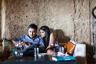 India - New Delhi - A couple at a table at the Hauz Khas Social