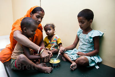 Children receive supplemental meals at the Swastha Kendra clinic operated by the NGO Calcutta Kids (calcuttakids.org) in the Fakir Bagan Howrah, India