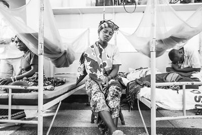 A mother sits with her child in Sekou Toure ICU paediatric unit of Sekou Toure Hospital, on Lake Victoria, northern Tanzania. (photo for the Touch Foundation).