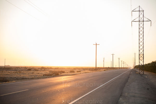 Straight countryside  road at sunset