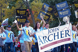 Republican supporters parade down Clinton St during the  University of Iowa homecoming Parade in Iowa City on Friday September 28, 2012. (Justin Torner/Freelance)
