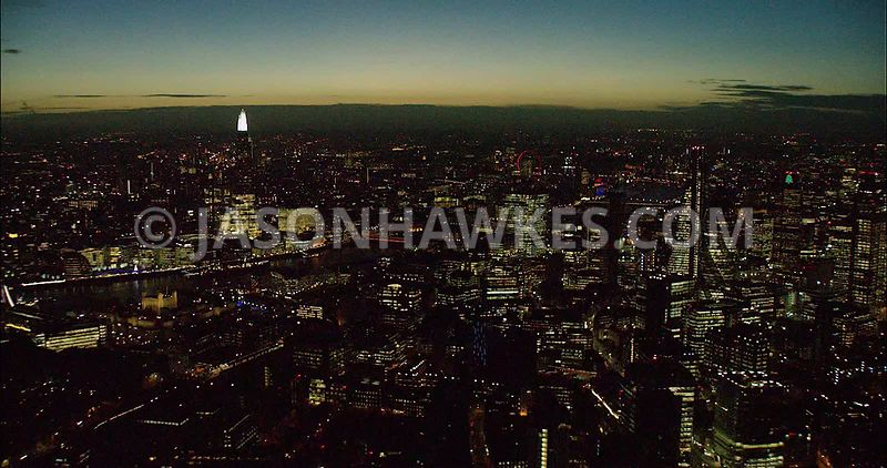 London night aerial footage, The Shard and City of London skyline at night.