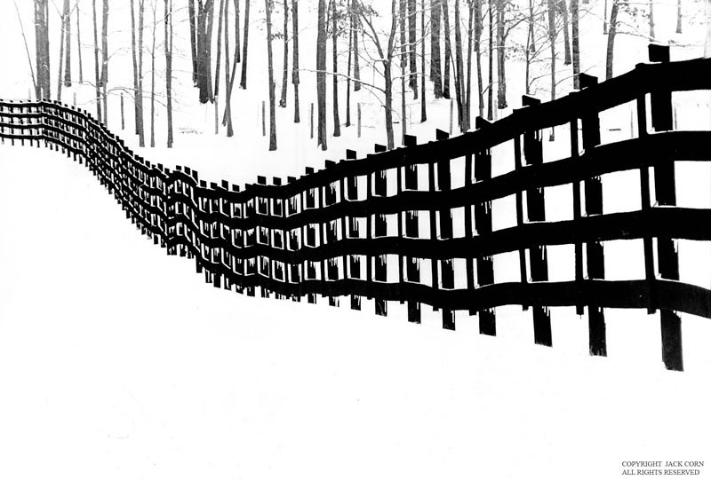 Black fence in snow