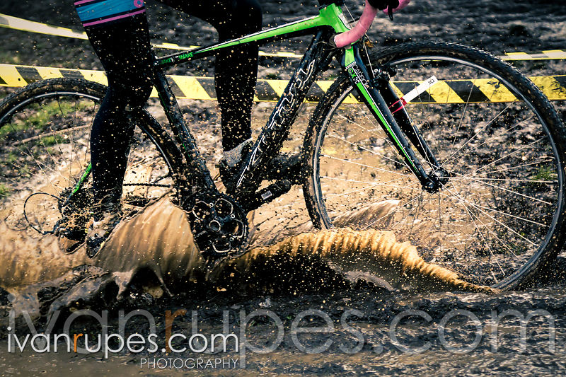 A rider cutting through a mud pit at Subway Cross, CX O-Cup #8; King's Mill Park, Etobicoke, On, November 22, 2015