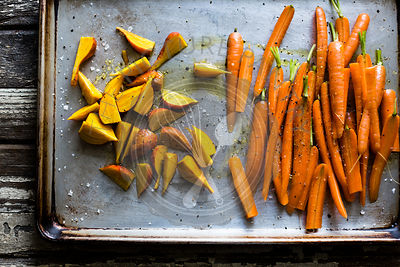 Raw Carrots and beets on a baking sheet