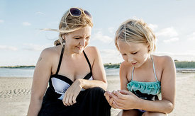 Young Nordic woman and girl on the beach 2