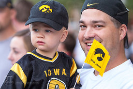 Jeremiah Lane, 2 and father Thad spectate the University of Iowa homecoming Parade on Clinton St in Iowa City on Friday September 28, 2012. (Justin Torner/Freelance)
