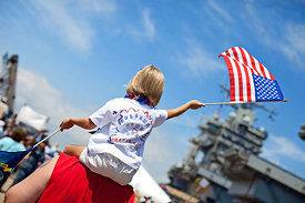 child_waving_american_flag