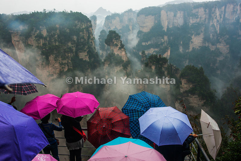 Wulingyuan National Forest Park, World Heritage site, where Avatar was filmed. Pics of Avatar Rock, made famous by the movie at sunset and photo concession at the most famous viewpoint though photo shop makes it possible to put the subject in any background they like