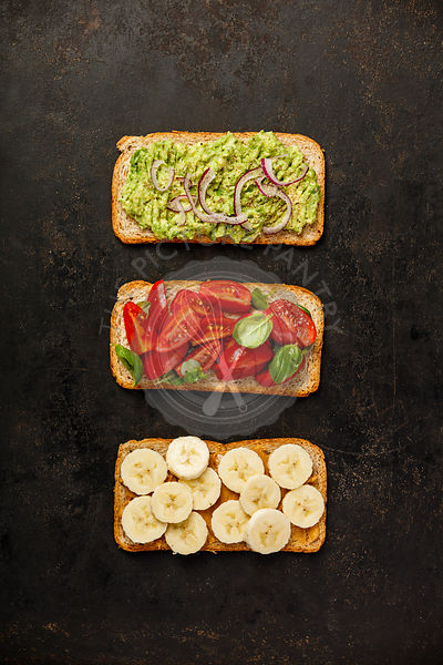 Healthy sandwiches on dark background