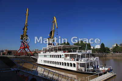 Puerto Madero docklands regeneration in Buenos Aires, Argentina, showing riverboat and restored cranes
