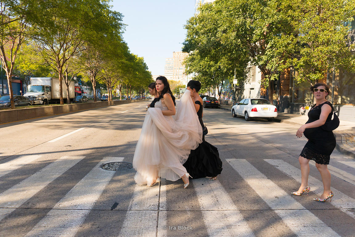 A bride and her bridesmaids walk by in Manhattan, New York City.