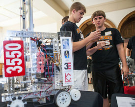 Cedar Falls High School students Zach Worthington and Collin McIntyre figure out Rubix cubes near a robot on display at the STEM Round Table Discussions. ?A Celebration of Science, Technology, Engineering and Mathematics (STEM) and FIRST in Iowa? kicked off at an event at the Iowa Memorial Union on Saturday, September 8, 2012 in Iowa City. (Justin Torner/Freelance)