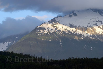 Stormclouds over an unknown peak in the the Tantalus Range, Southern Mainland, British Columbia.