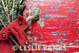 Red vintage table background with evergreen