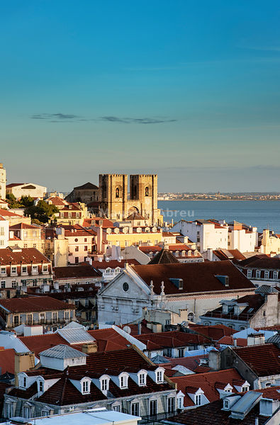 Rooftops of the Baixa, the historic centre of Lisbon, with the Tagus river and the Motherchurch on the background, at twilight. Lisbon, Portugal