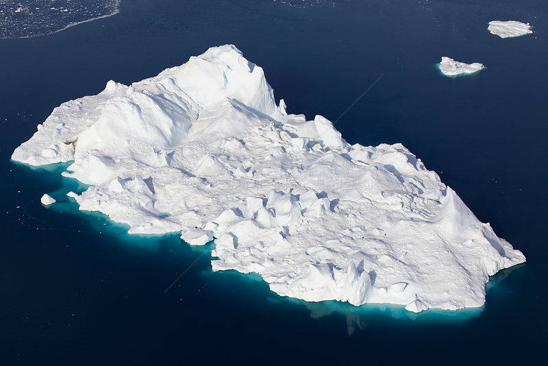 Aerial view of an iceberg in the Ilulissat Icefjord, where the Sermeq Kujalleq Glacier or Jakobshavn Isbrae enters the sea, near Ilulissat, UNESCO World Heritage Site, Kalaallit Nunaat, Greenland. August 2014.