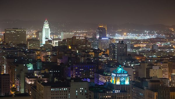 Bird's Eye: Spread of Mid-rises & L.A. City Hall In Lights On A Humid Night