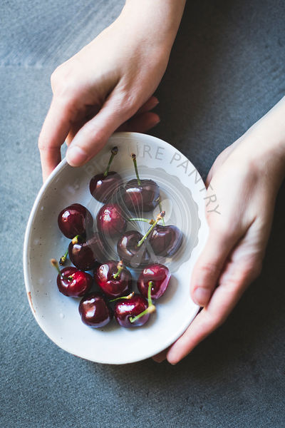 Ripe red cherries in a bowl.
