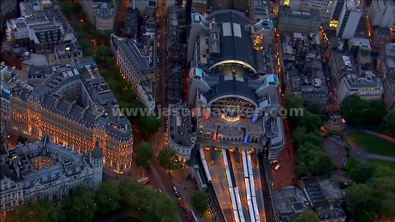 Aerial footage of Charing Cross Station at night, London, England, UK