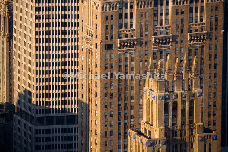 Two major examples of Art Deco architecture built in the early 20th-Century, the Lincoln Building and 295 Madison Avenue flaunt adornments, unlike the stark, angular MetLife Building.  Manhattan, New York City.