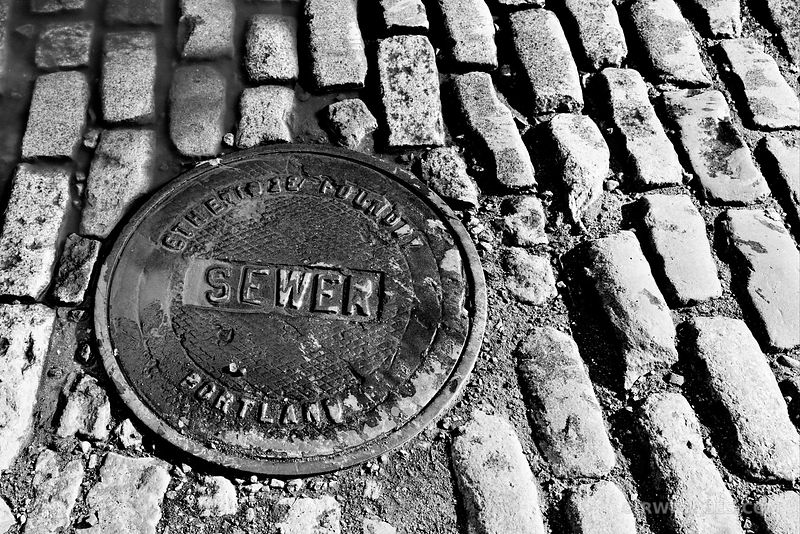 COBBLESTONES AND SEWER PORTLAND MAINE BLACK AND WHITE