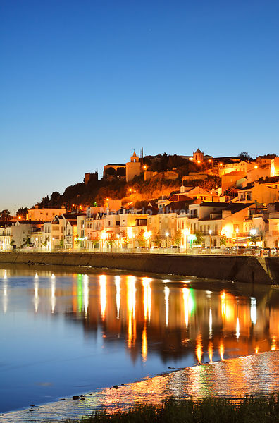Alcacer do Sal and Sado river at night. Portugal
