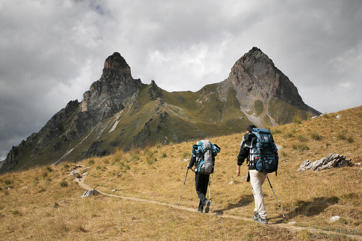 Backpackers on trail below peak