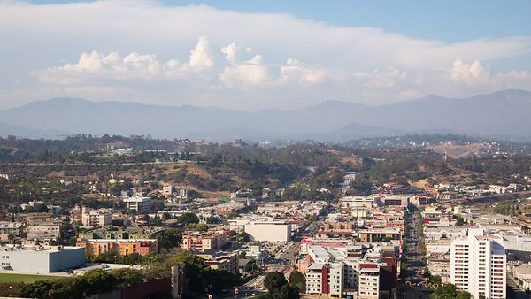 Wide Shot: A View Over Chinatown and the Cloud Covered San Gabriel Mountains